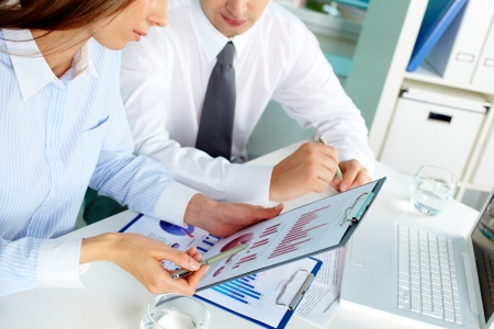 white collar workers: Image of two white collar workers during discussion of business documents at meeting Stock Photo