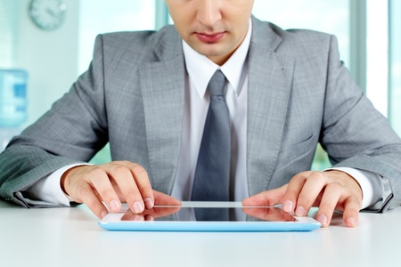 Image of businessman working with digital tablet at workplace photo