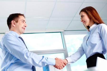 handshaking: Photo of business partners handshaking after striking deal Stock Photo