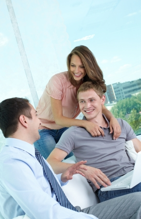 financial adviser: Vertical shot of a cheerful family meeting with the financial adviser