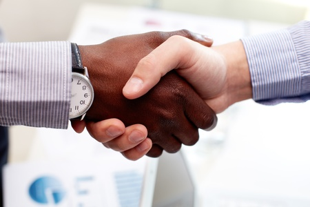 trustful: Close-up of businessmen shaking hands, Caucasian and African-American