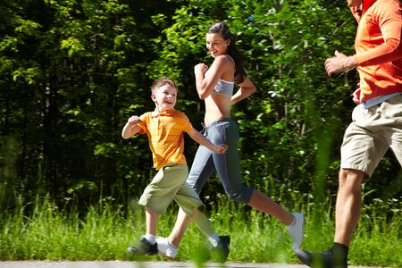 proving: Happy running family proving the well-known saying �Life is motion� Stock Photo