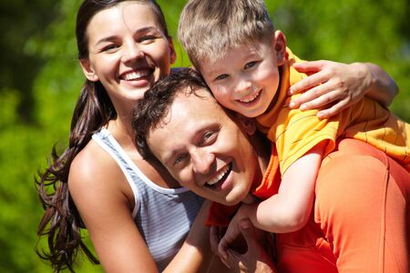 family time: Portrait of a lovely family having good time outdoors Stock Photo