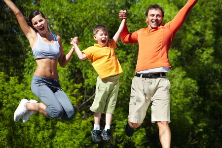 Simultaneous family jump manifesting love for life and vitality photo