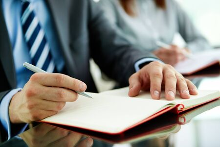 summary: Close-up of a business worker with a blank notebook