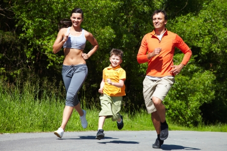 family exercise: Lovely family jogging in the open air Stock Photo