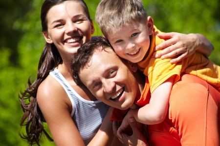 emotional woman: Portrait of a lovely family having good time outdoors Stock Photo