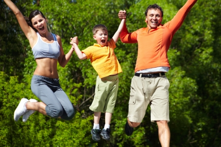 dynamic activity: Simultaneous family jump manifesting love for life and vitality