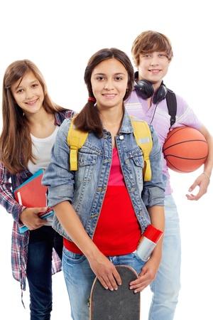 Retrato de tres amigos adolescentes aislados sobre fondo blanco Foto de archivo