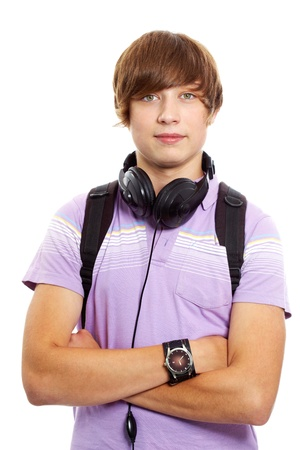 handsome teenage guy: Good-looking young man standing cross-armed and looking at camera