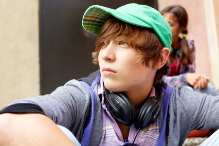 Contemplating teenager spending time outdoors in summer photo
