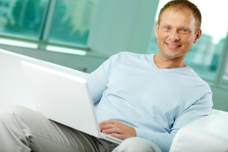 Portrait of a positive-looking man using modern technology photo