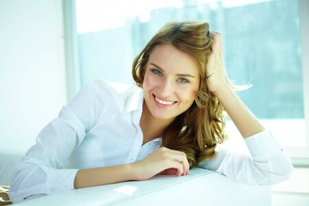 tempting: Image of a young woman with a lovely look and charming smile Stock Photo
