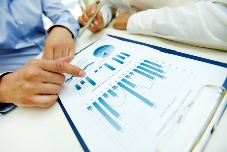 charts: Close-up of graphs and charts analyzed by business people