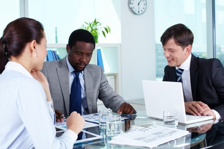Portrait of business team discussing documents at meeting Stock Photo - 14469632