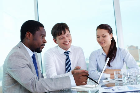 Portrait of group of employees working with laptop at meeting Stock Photo - 14469692