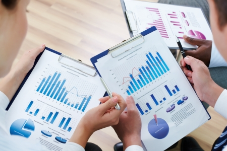 financial planning: Image of human hands during discussion of business documents at meeting Stock Photo