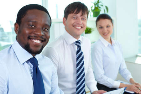 Portrait of successful business team with their leader in front Stock Photo - 14469664