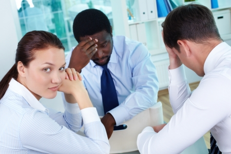 unsatisfactory: Portrait of sad business team sitting in office Stock Photo