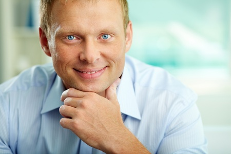 Portrait of handsome businessman looking at camera photo