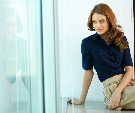 perfect fit: Image of calm woman in smart casual looking aside Stock Photo