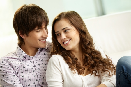 teen couple: Affectionate couple spending time together at home