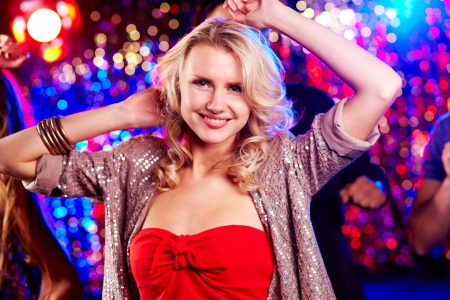 disco girls: Image of energetic girl looking at camera while dancing at party Stock Photo
