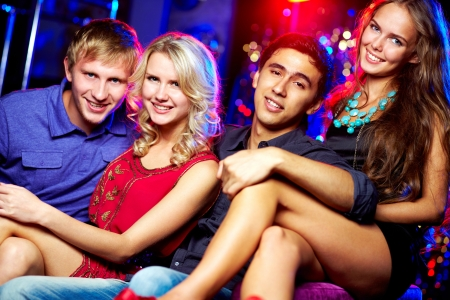 Image of happy couples at party in the night club photo