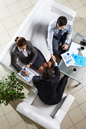 financial official: Vertical shot of business people shaking hands Stock Photo