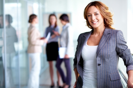 women business: Business lady with positive look and cheerful smile posing for the camera