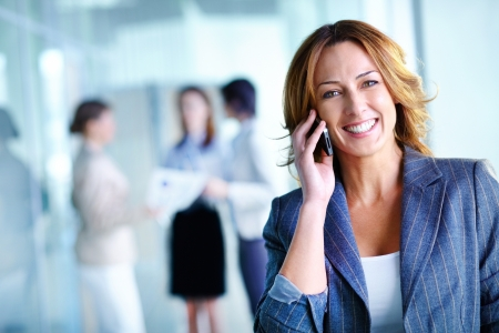 happy client: Office worker making a phone call understanding the importance of positive attitude Stock Photo