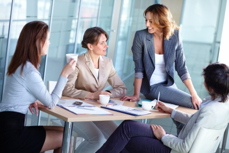 Pretty females discussing business matters in the boardroom Stock Photo - 14474101