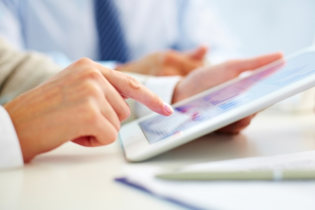 touchpad: Female office worker using touchpad Stock Photo