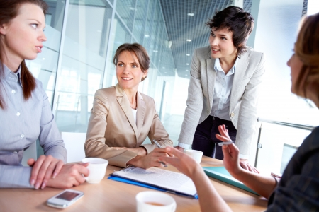 excited woman: Female business team of four working together to achieve good results Stock Photo