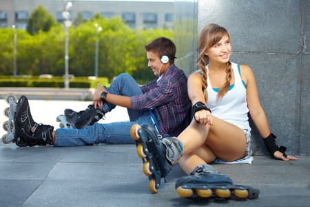 Teenagers hanging out at popular meeting spot for rollers photo