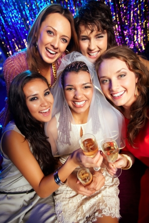 wedding party: Group of friends drinking to the health and happiness of the bride