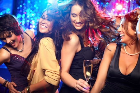 nightclub crowd: Cheerful girls living it up on the dance floor Stock Photo