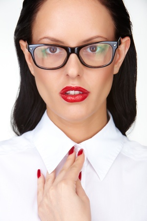 Gorgeous woman with red lips and eyeglasses looking at camera photo