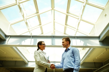 concluding: Business people shaking hands concluding a deal or greeting each other