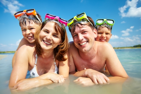 family photo: Photo of happy family looking at camera during summer vacation Stock Photo