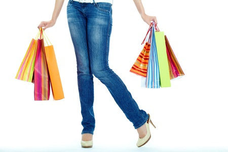 Image of shopaholic legs and shopping bags in hands Stock Photo - 14519512
