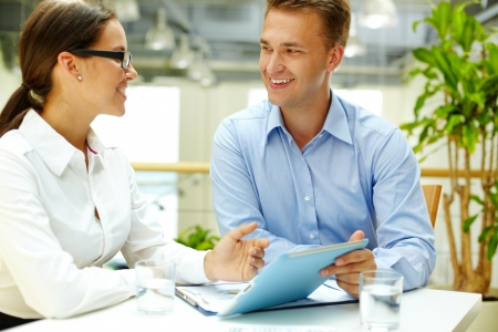 Positive office workers choosing the best business solution photo