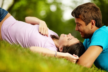 dating and romance: Happy guy and girl spending time together in park enjoying each other's company Stock Photo