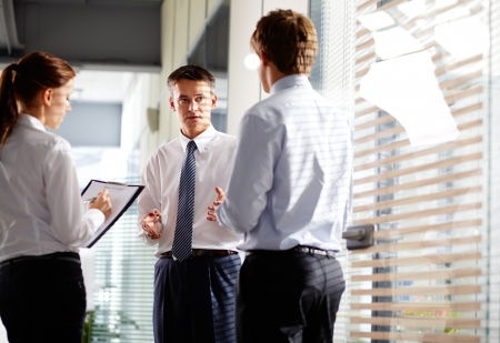 advising: Business group quickly make changes in their pal before meeting with partners Stock Photo