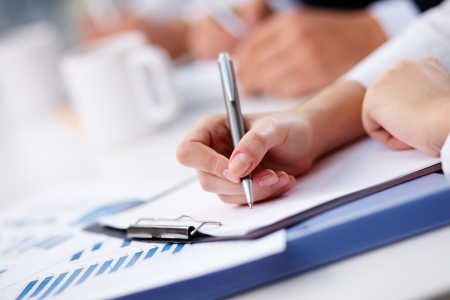 ball pen: Female being ready to take notes at seminar Stock Photo