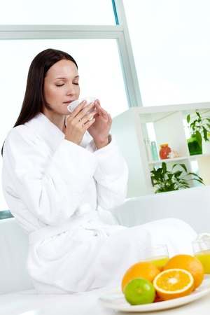Frequenter of the spa salon enjoying every peaceful minute after beauty procedures photo