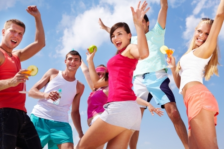 dynamic activity: Group of lovely young people dancing and jumping outdoor Stock Photo
