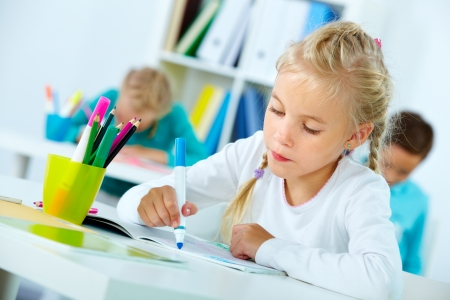 artworks: Portrait of lovely girl drawing with classmates on background