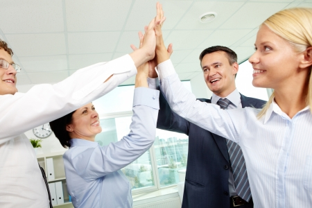 team victory: Cheerful business team holding their hands together with enthusiasm Stock Photo