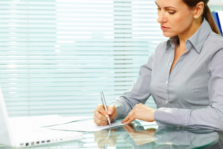 corporation: Business lady putting signatures on documents
